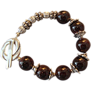 SOLD Garnet and Bali Silver Bracelet