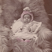 SALE Adorable Baby Girl in a Pink Bonnet and Booties, Reclining in Fur, Victorian Antique ...