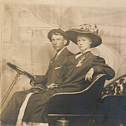 Pretty Young Lady in Flowered Hat and Suitor Posing in Car, Vintage Real Photo Postcard ...