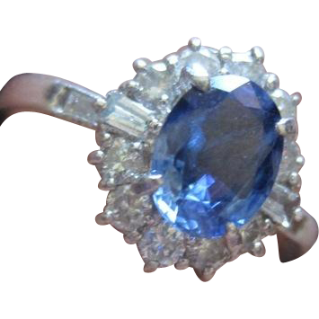 traditional vintage oval sapphire ring surrounded by