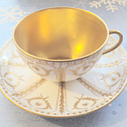 White Royal Doulton Teacup with Gold Trim and Gold Painted Inside