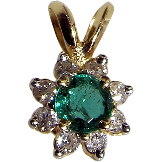 Item id small emerald diamond pendant in shop s backroom