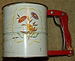 Vintage 1952 Androck Hand-i-Sift &quot;Flower&quot; Theme Three Screen Flour Sifter Red Wooden Handle