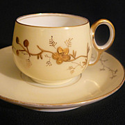Antique Elite Limoges gold paste porcelain cup and saucer set