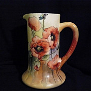 Poppies on Limoges pitcher with vibrant hand painting
