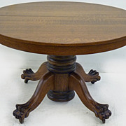 Round Oak Pawfoot Table, 2 skirted Lvs