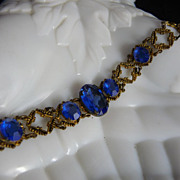 Art Deco Gilt Brass Bracelet with Faceted Oval Blue Glass Stones