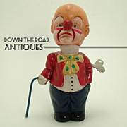 Early Occupied Japan Clown with Rotating Cane Wind-up Toy