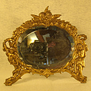 Oval Dresser Mirror with Full Figural Cupids
