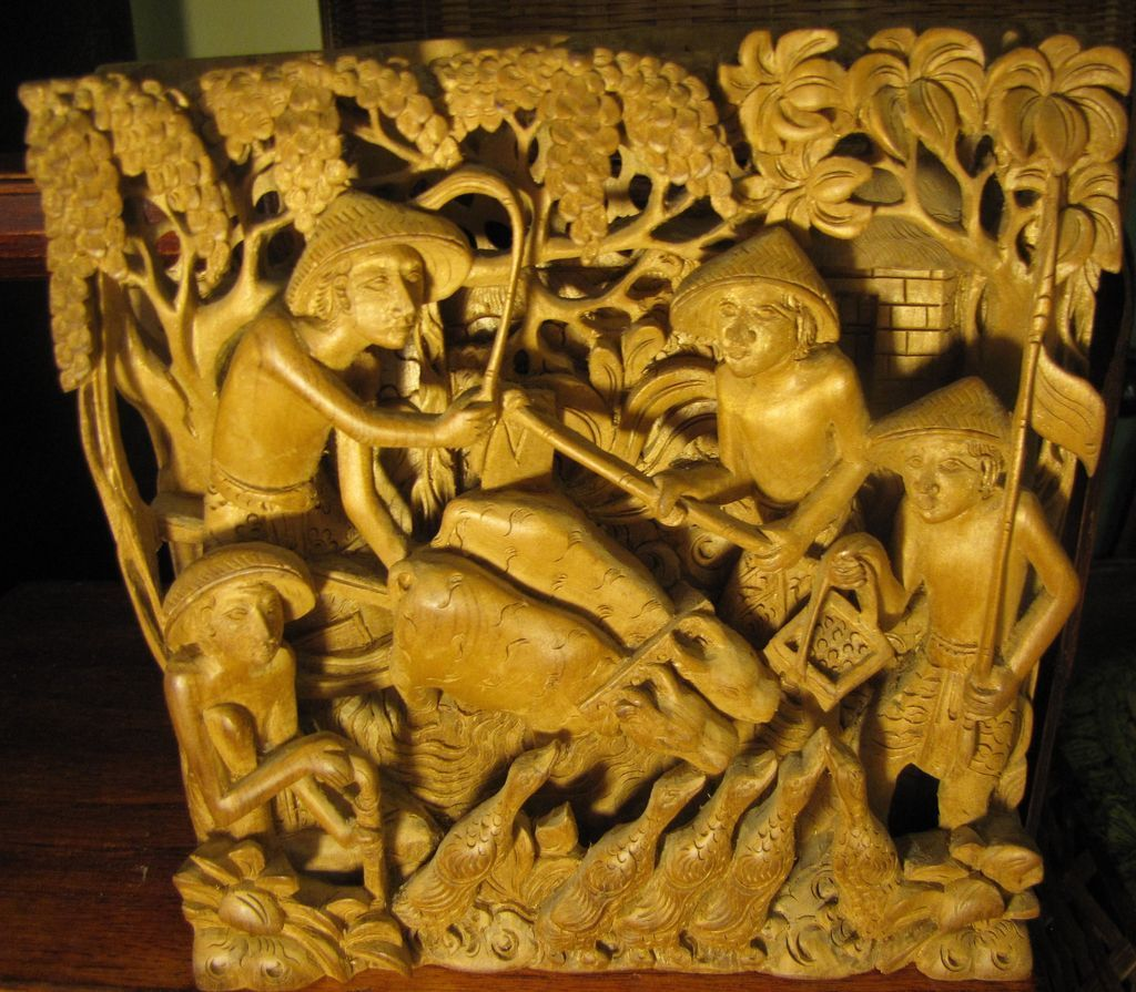 Deep relief asian carving men birds cattle stunningly