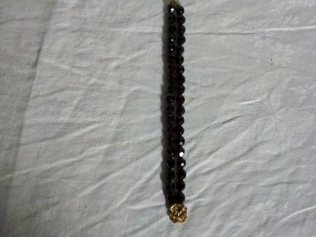 Item ID: Jet Black Bracelet In Shop's Backroom