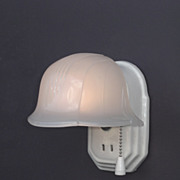 Vintage white porcelain wall light fixture with helmet shade.