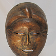 African Hand Carved Wood Mask on Stand