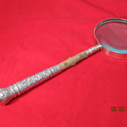 Circa 1875 Sterling Repousse Magnifying Glass