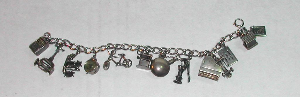 c.1950s Sterling  Charm Bracelet Moveable Parts Piano Clock Bicycle etc