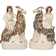 Rare Pair of 19th Century Staffordshire Figures of Children on Goats