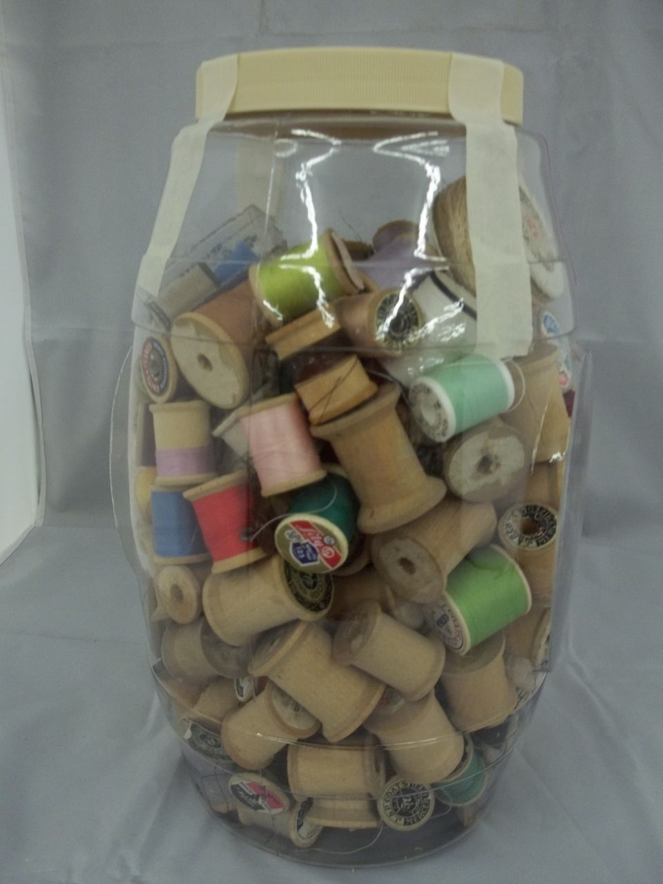 Vintage Wooden Spools in Gallon Jar