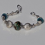 Sterling Silver and Green/Caramel Lampwork Bracelet