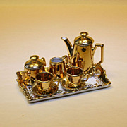 Porcelain Coffee Service with gilt painting and flowers