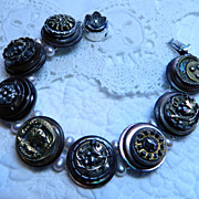 "Handcrafted Bracelet with Antique Victorian Metal Buttons ""Metal- Morphosis"""