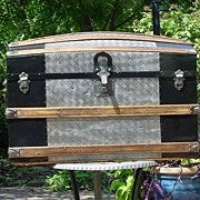 Restored Antique Humpback Embossed Tin Trunk