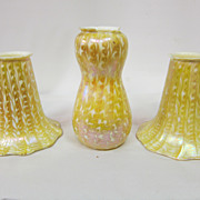 Set of three signed Quezal decorated lamp shades