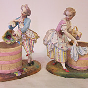 A pair of 19th century bisque figurines