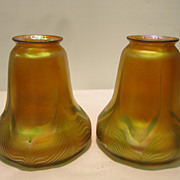 Pair of gold iridescent pulled feather &quot;Quezal&quot; art glass shades