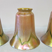 Three Quezal pulled feather shades