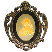 Arabesque porcelain head  with decorative frame