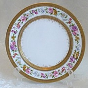 Limoges Porcelain Plate with Floral Pattern and Extensive Gold Borders