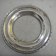 Sterling rimmed wine bottle coaster