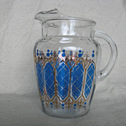 Atomic Era Clear Pitcher With Ice Lip in Blue and Gold Design