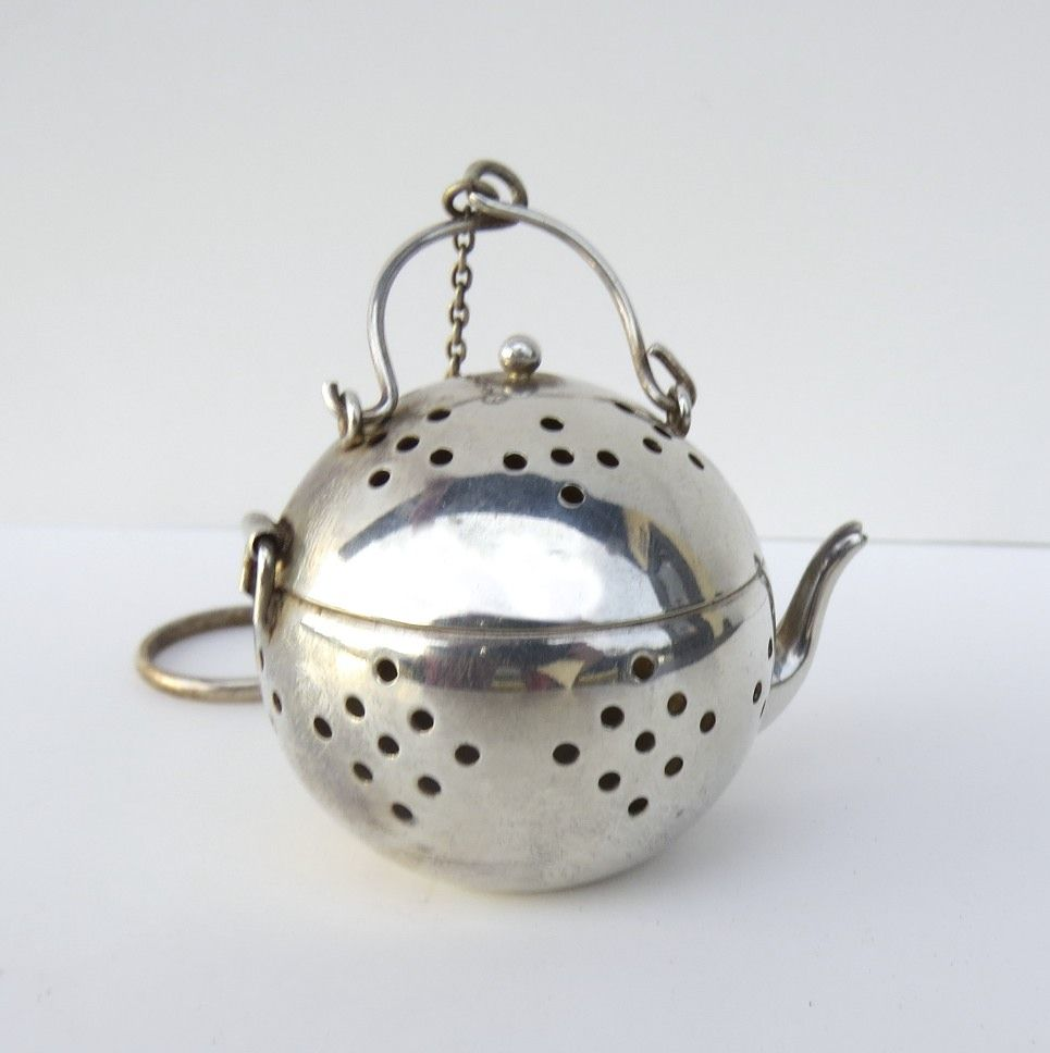 Delightful Silverplate Tea Strainer with Gold Wash