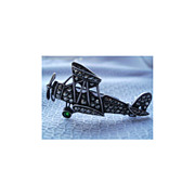 SOLD SOLD Airplane shaped Pin / Brooch in Marcasite with Emerald colored wheel