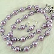 Lavender Dyed Glass Pearls and Swarovski Tanzanite Crystals with Silver Plated finding Hand ..