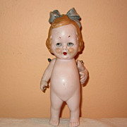 German pink tinted all bisque doll intaglio eyes bow