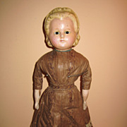 Antique pumpkin head doll brown dress