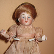 Miniature bisque dollhouse doll #5012 pink dress