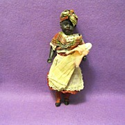 SOLD Old black bisque head, glass eyed doll, original clothes