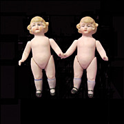 Twin Antique All-bisque Dolls