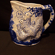 Dedham Pottery Night/Day Pitcher
