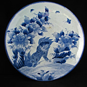 Large 19th century blue and white Japanese Imari charger with lion and peony design