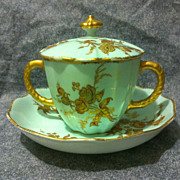 SALE Royal Crown Derby double handled covered cup with saucer in pale blue with raised golden
