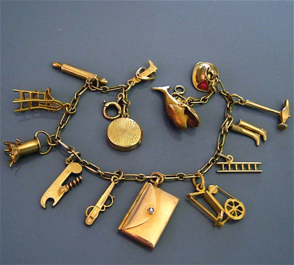 vintage 14k gold charm bracelet movable mechanical