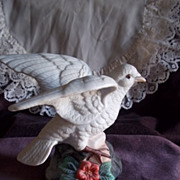 White Porcelain Dove Perched on a Rock w/ Flowers