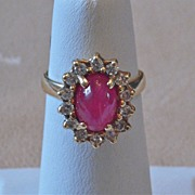 14 Carat yellow gold Oval Cab Ruby Surrounded by brilliant cut diamonds 1940-1960's