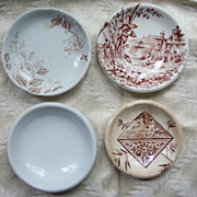 Lot of 4 Brown Transfer Ware Butter Pats