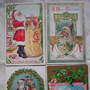Set of Four Santa Postcards - Early 1900's