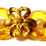 Fascinating Bracelet with Amber Glass Links & Filigree Bows